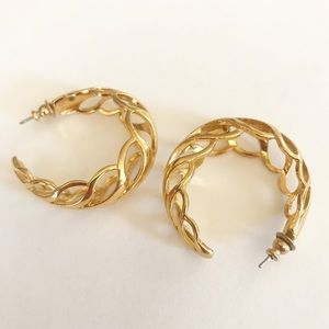 Gold Hoop earrings with swirl pattern.